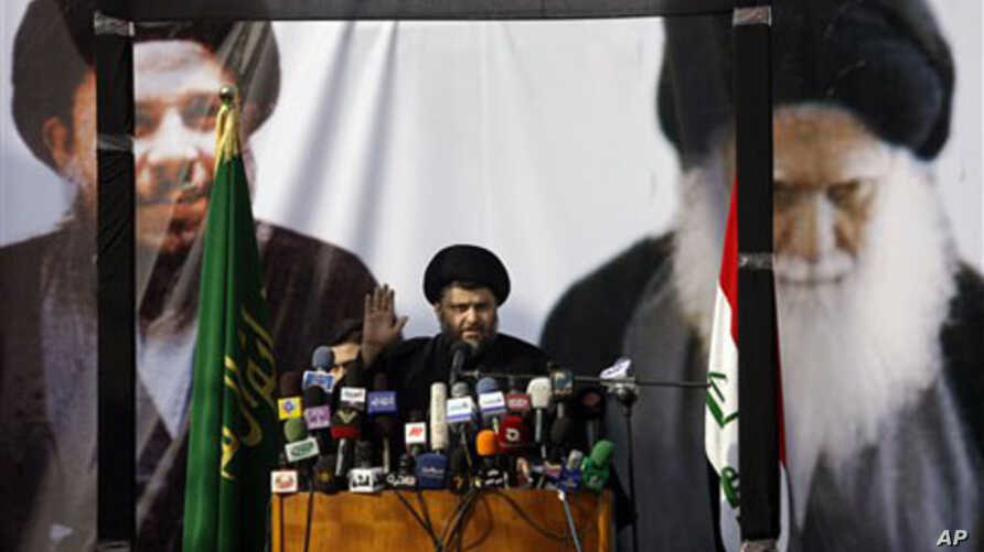 Shi'ite cleric Moqtada al-Sadr gestures during his first public appearance since returning from nearly four years of self-imposed exile in Najaf, south of Baghdad, Iraq, 08 Jan 2011