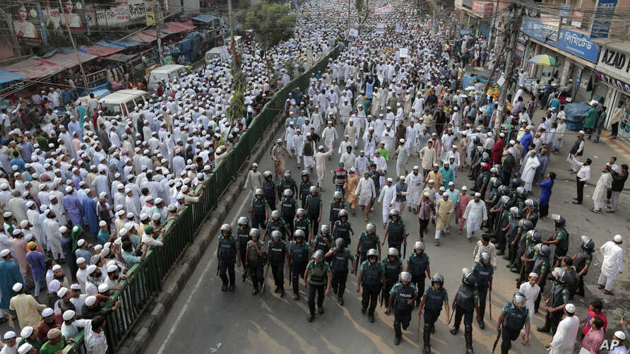 FILE - Bangladeshi activists of several Islamic groups attend a protest rally against the persecution of Rohingya Muslims in Myanmar, after Friday prayers in Dhaka, Bangladesh, Nov. 25, 2016.