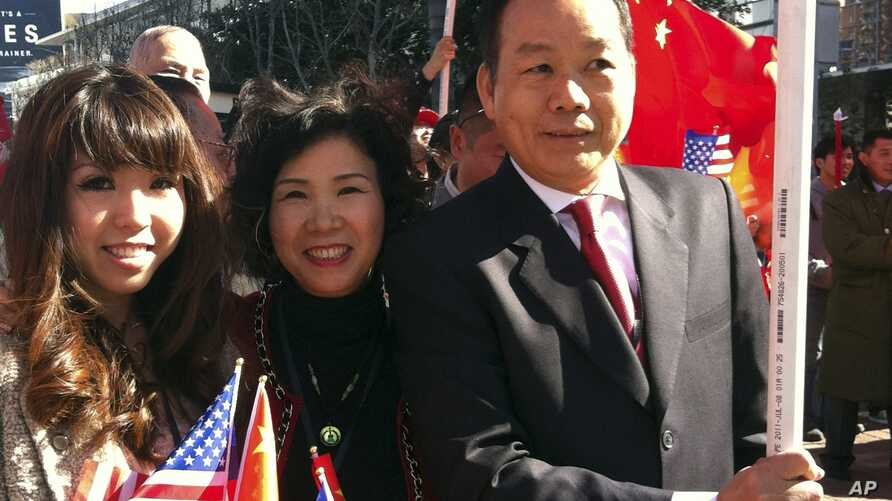 FILE - American businessman Vincent Wu, right, poses for a photo with his wife Yip Lai Fong, center, and daughter Anna Wu as they wait to welcome China's then-Vice President Xi Jinping on his visit to Los Angeles, Calif.