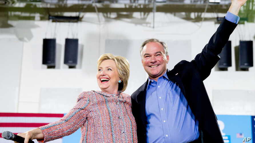 Democratic presidential candidate Hillary Clinton and Sen. Tim Kaine, D-Va., participate in a rally at Northern Virginia Community College in Annandale, Va., Thursday, July 14, 2016.