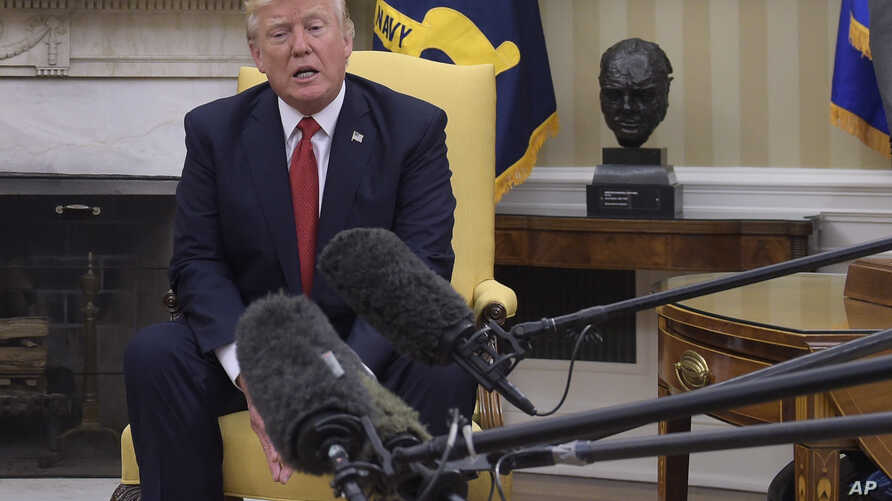 President Donald Trump speaks in the Oval Office of the White House in Washington, May 18, 2017.