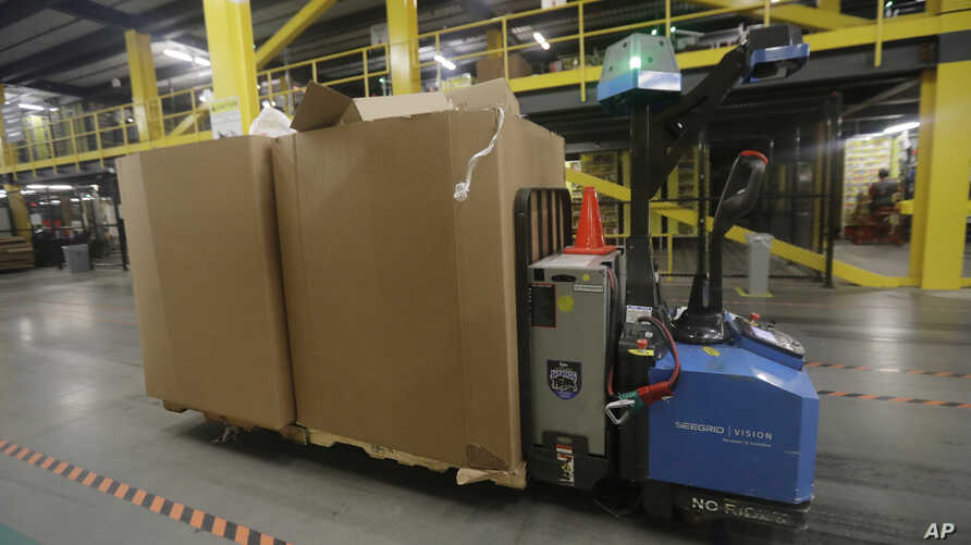 A robot carries boxes at the Amazon Fulfillment center in Robbinsville Township, New Jersey,  Aug. 1, 2017.