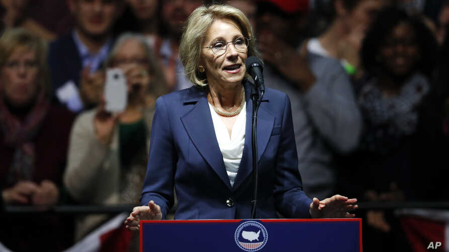 Betsy DeVos, selected for education secretary by President-elect Donald Trump, speaks in Grand Rapids, Mich., Dec. 9, 2016. DeVos and her organization, the American Federation for Children, have been advocates the distribution of more federal funding