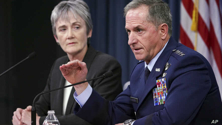 Gen. David L. Goldfein, chief of staff of the U.S. Air Force, and Air Force Secretary Heather Wilson speak during a news briefing at the Pentagon, Nov. 9, 2017.