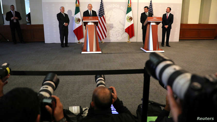Secretary of Homeland Security John Kelly delivers a statement accompanied by U.S. Secretary of State Rex Tillerson (left), Mexico's Foreign Secretary Luis Videgaray (right), and Secretary of Government Angel Osorio (far right) at the Ministry of For