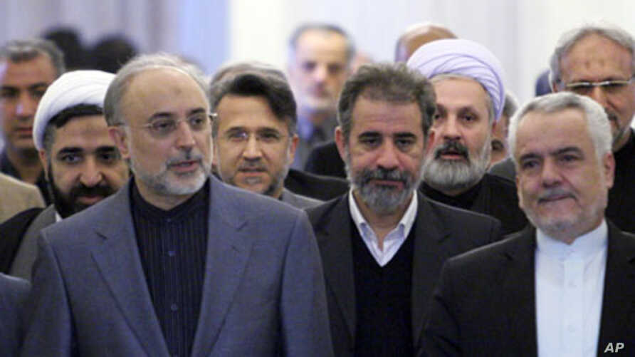 Ali Akbar Salehi, head of Iran's Atomic Energy Organisation (front, L), arrives for former Foreign Minister Manouchehr Mottaki's official farewell ceremony in Tehran, 18 Dec 2010