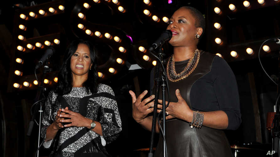 FILE - From left, Essence President Michelle Ebanks and Essence Editor-in-chief Vanessa Bush speak at the 5th Annual Essence Black Women in Music reception, Jan. 22, 2014, at 1 OAK in Los Angeles, California.