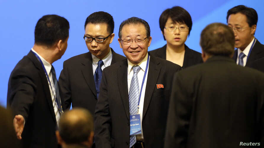 North Korea's First Vice Foreign Minister and envoy to the six party talks Kim Kye-gwan (C) arrives for the opening ceremony of the 10th anniversary of the six party talks at Diaoyutai State Guesthouse in Beijing, Sept. 18, 2013.