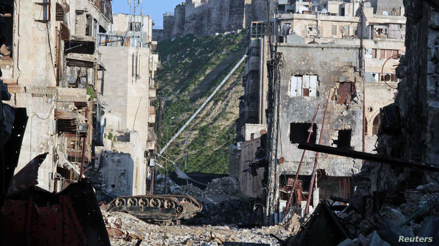 An overturned tank is seen in a damaged Khan Wazir street, which faces Aleppo's historic citadel controlled by forces loyal to Syria's President Bashar al-Assad, in Old Aleppo, Syria.