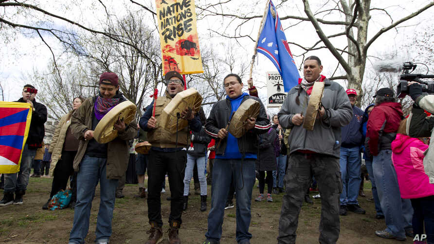 America Indians and their supporters protest outside of the White House, Friday, March 10, 2017, in Washington, to rally against the construction of the disputed Dakota Access oil pipeline.