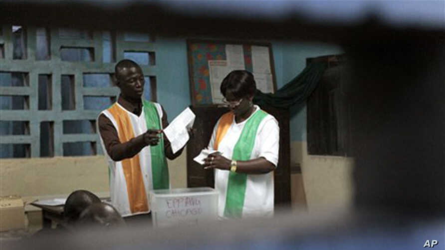 Election officials start counting ballots in the first round of presidential elections in Abidjan, Ivory Coast, Sunday Oct. 31, 2010.