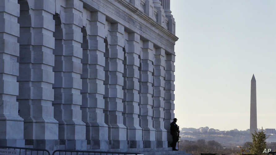 A lone Capitol Police officer guards his post, Jan. 19, 2018, on Capitol Hill in Washington.