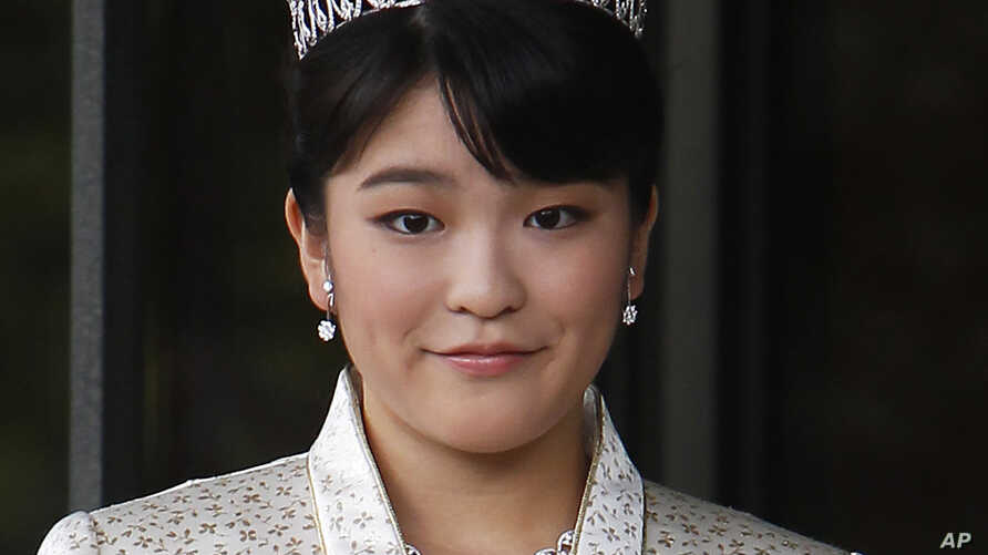 FILE - Japan's Princess Mako, the first daughter of Prince Akishino and Princess Kiko, poses for photos at Imperial Palace in Tokyo. Mako, the granddaughter of Emperor Akihito, is getting married to an ocean lover who can ski, play the violin and coo
