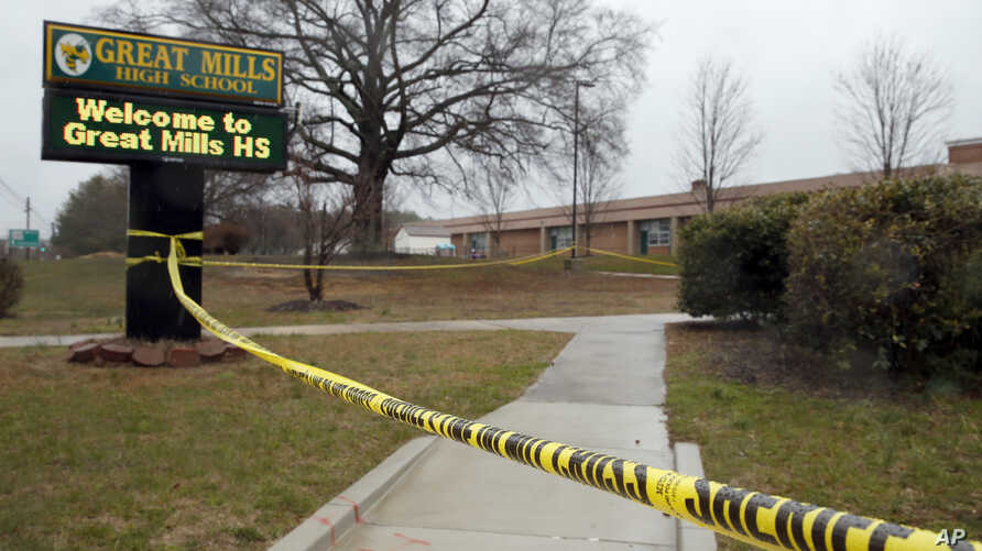 Crime scene tape is used around Great Mills High School, the scene of a shooting, March 20, 2018, in Great Mills. A student with a handgun shot two classmates inside the school before he was fatally wounded during a confrontation with a school resour