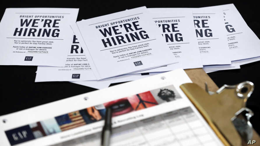 Job applications and information on U.S. clothing retailer GAP are seen on a table during a job fair at a shopping center in Miami, Florida, Oct. 6, 2015.