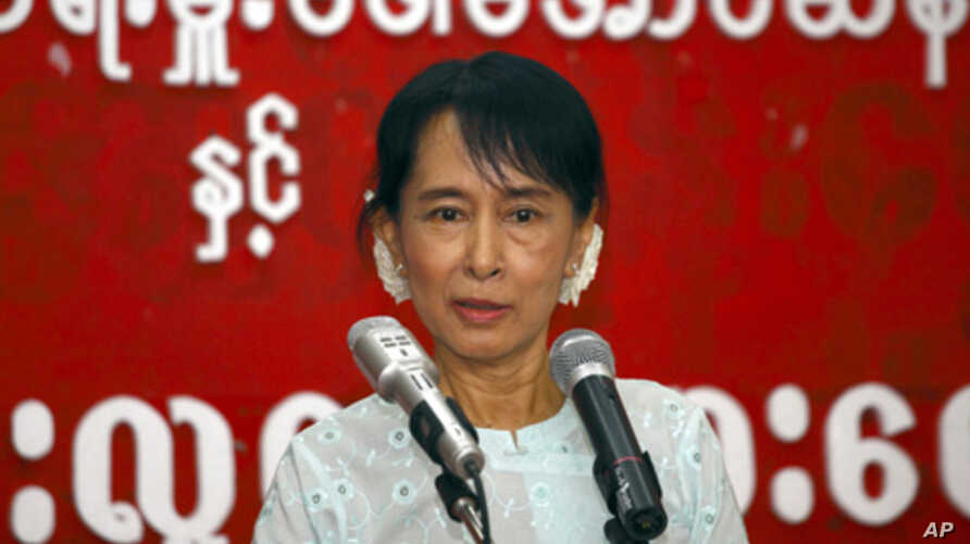 Burma's pro-democracy leader Aung San Suu Kyi speaks with youths at the National League for Democracy headquarters in Rangoon, February 8, 2011.