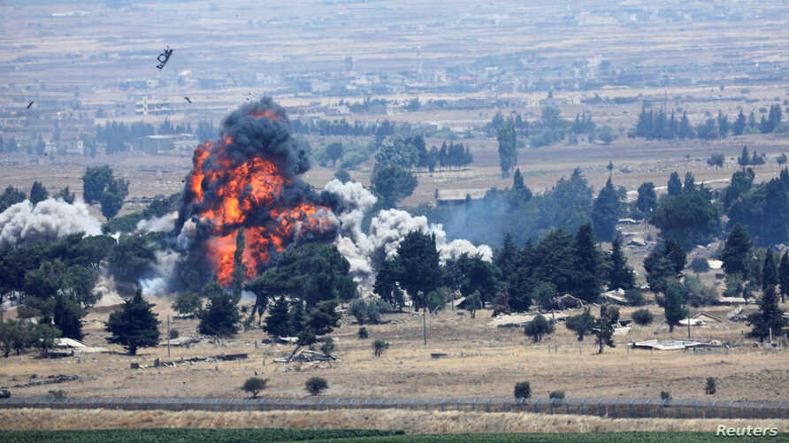 An explosion is seen at Quneitra at the Syrian side of the Israeli Syrian border as it is seen from the Israeli-occupied Golan Heights, Israel, July 22, 2018.