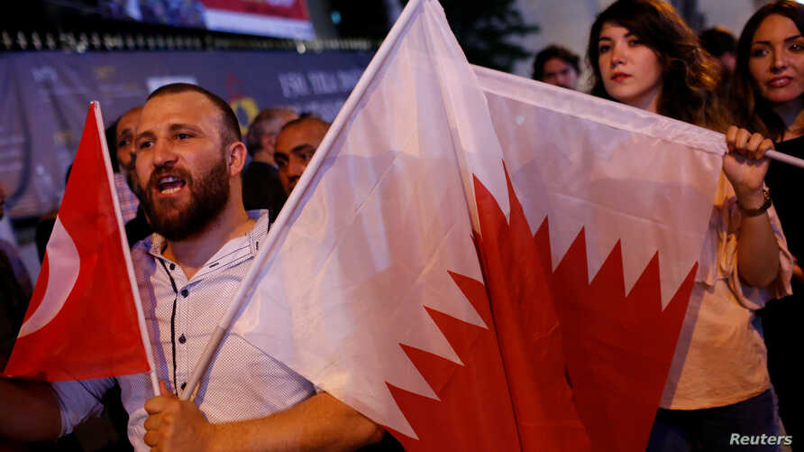 People shout slogans as they hold Turkish and Qatari flags during a demonstration in support of Qatar in central Istanbul, Turkey, late June 7, 2017.
