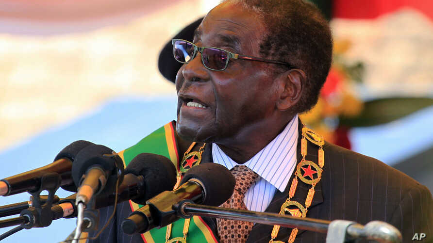 Zimbabwean President Robert Mugabe delivers his speech during a ceremony to honor thousands of fighters who died in the 1970s Bush war  against colonialism, in Harare, Aug. 10, 2015.