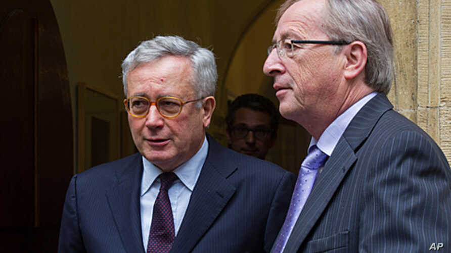 Luxembourg's Prime Minister and the chairman of the Eurogroup meetings of eurozone nations, Jean Claude Juncker, right, and Italy's Finance Minister Giulio Tremonti leave Juncker's office after a meeting in Luxembourg, Aug. 3, 2011