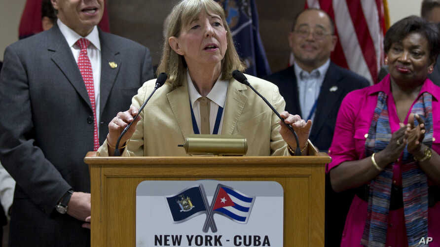 FILE - Dr. Candace S. Johnson, president and CEO of Roswell Park Cancer Institute, announces the signing of an agreement to test a Cuban lung cancer treatment in the U.S., before the New York delegation leaves the Jose Marti International Airport in