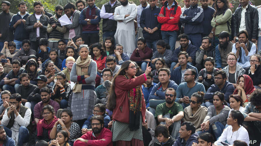 A student makes her speech as Jawaharlal Nehru University students gather for a protest against the arrest of a student union leader in New Delhi, India, Feb. 15, 2016.
