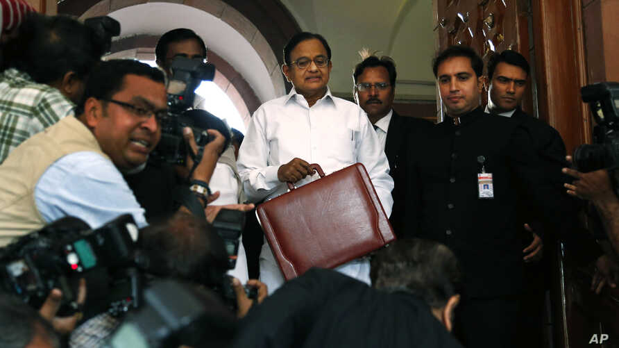 Indian Finance Minister Palaniappan Chidambaram, center, arrives at Parliament to present the annual budget in New Delhi, February 28, 2013.