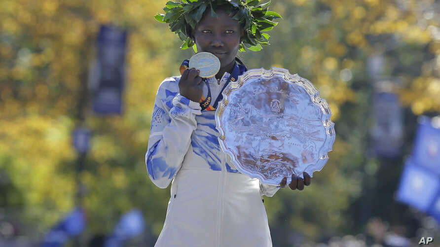 First place finisher Mary Keitany of Kenya poses for a picture at the finish line of the New York City Marathon in New York, Sunday, Nov. 4, 2018.
