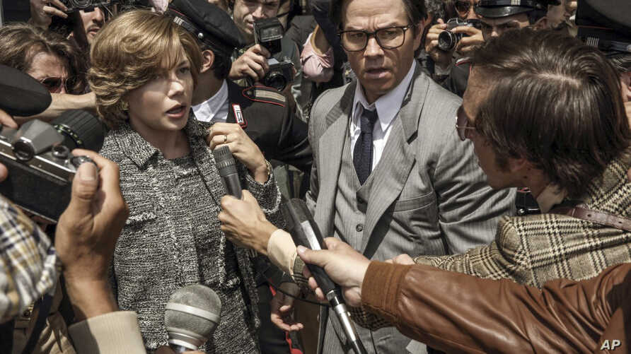 "FILE - This image from Sony Pictures shows Michelle Williams, left, and Mark Wahlberg in ""All The Money in the World."" After an outcry over a significant disparity in pay with Williams, Wahlberg has agreed to donate the $1.5 million he earned for res"