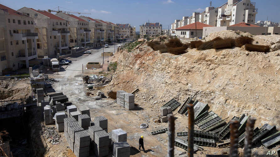 FILE- In this March 14, 2011, file photo, a general view of a construction site in the West Bank Jewish settlement of Modiin Illit.  Israel approved the construction of 3,000 homes in Jewish settlements in the West Bank and east Jerusalem, a governme