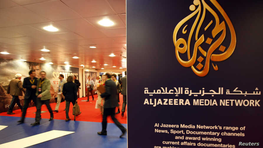 FILE - The logo of  Al Jazeera Media Network is seen at the MIPTV, the International Television Programs Market, event in Cannes.