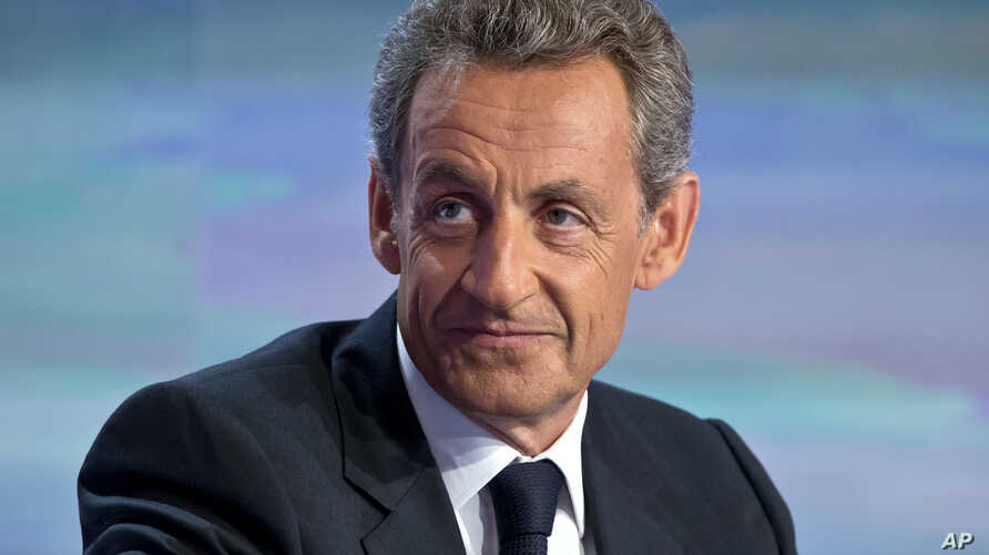 FILE - Former French President Nicolas Sarkozy, poses prior to a TV interviews at French TV station TF1 in Boulogne-Billancourt, outside Paris, Aug. 24, 2016.
