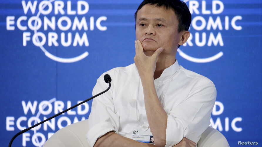 """Chairman and chief executive of Alibaba Group Jack Ma reacts during a session of """"Future-Proofing the Internet Economy"""" at the World Economic Forum (WEF) in China's port city Dalian, September 9, 2015."""