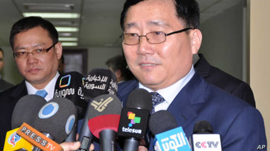 Chinese Ambassador Li Huaxin speaks to reporters after he met with Syrian assistant Foreign Minister Ahmed Arnus, March 6, 2012.