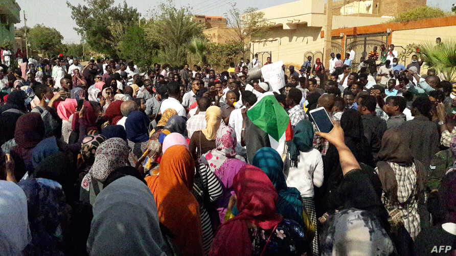 FILE - Sudanese protesters chant slogans during an anti-government demonstration in the capital Khartoum's twin city of Omdurman on Jan. 31, 2019.