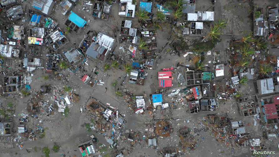 A general view shows destruction after Cyclone Idai in Beira, Mozambique, March 16-17, 2019 in this still image taken from a social media video on March 19, 2019. (Care International/Josh Estey)