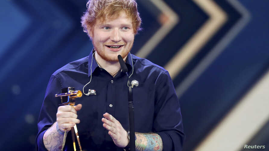 FILE - British singer Ed Sheeran poses with the 'Golden Camera' ('Die Goldene Kamera') award during the ceremony of German TV magazine 'Hoer Zu' in Hamburg, March 4, 2017.