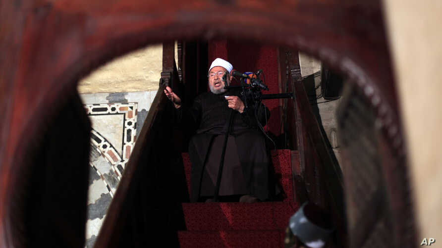 FILE -- Shiekh Youssef al-Qaradawi, gives a sermon during Friday prayers at al-Azhar mosque in Cairo, Egypt.