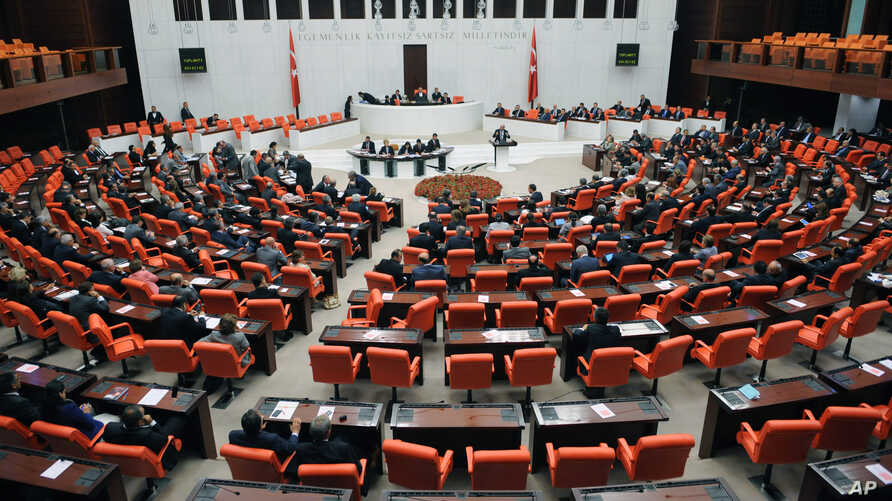 Lawmakers are seen during a debate at Turkey's parliament in Ankara, Oct. 4, 2012. Turkey fired on Syrian targets for a second day Thursday, but said it has no intention of declaring war, despite tensions after deadly shelling from Syria killed five