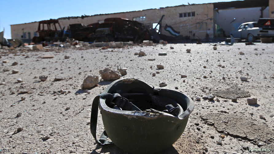 A helmet belonging to an Islamic State militant is seen on the ground at the 121 Regiment base after Fighters from the Democratic Forces of Syria took control of the base in the town of al-Melabiyyah, south of Hasaka city, Syria, Nov. 24, 2015.