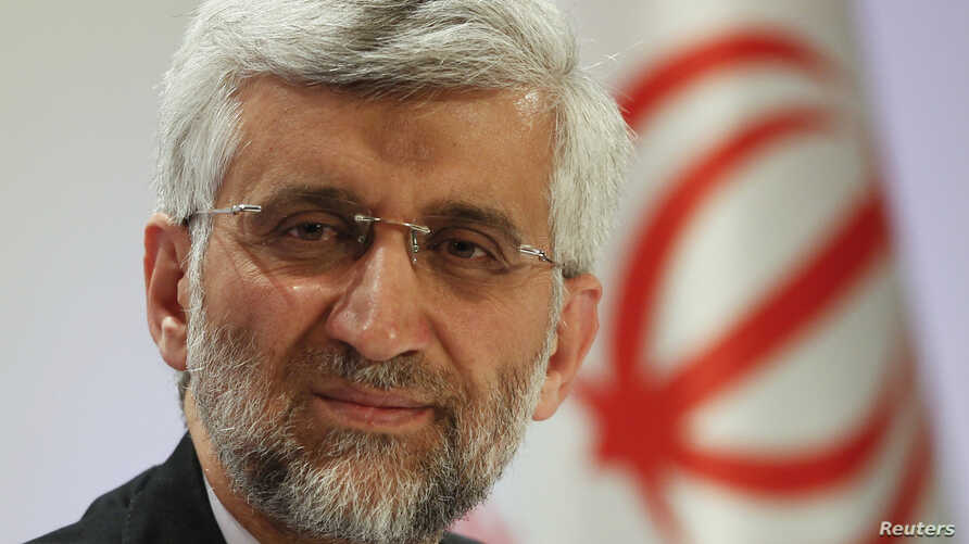 Iran's Supreme National Security Council Secretary and chief nuclear negotiator Saeed Jalili listens during a news conference in Almaty, Kazakhstan, Feb. 27, 2013.