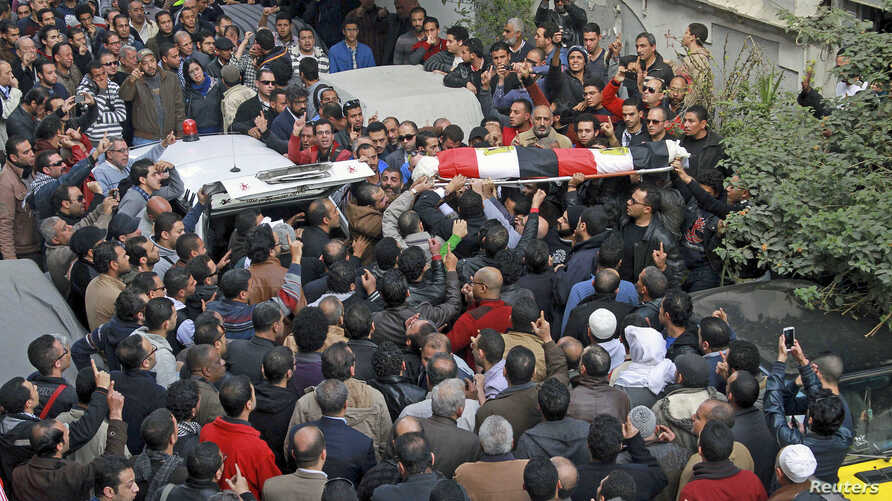 Relatives, friends and other mourners attend the funeral of Shaimaa al-Sabbagh, an activist at the Socialist Popular Alliance Party, during her funeral in Alexandria, Egypt, January 25, 2015.
