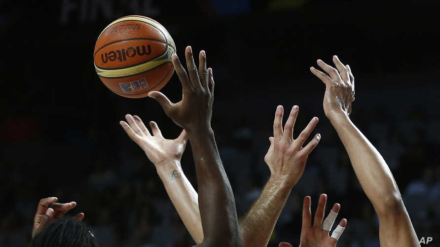 FILE - United States' and Serbia's players go for the ball during the final World Basketball match between the United States and Serbia at the Palacio de los Deportes stadium in Madrid, Spain, Sept. 14, 2014. The first women's basketball World Cup wi