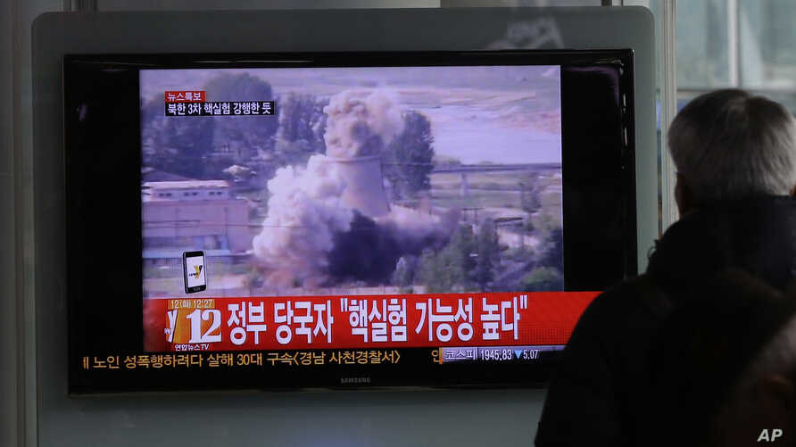 A South Korean man watches a TV news showing a file footage of North Korea's nuclear test at the Seoul train station in Seoul, South Korea, Feb. 12, 2013.