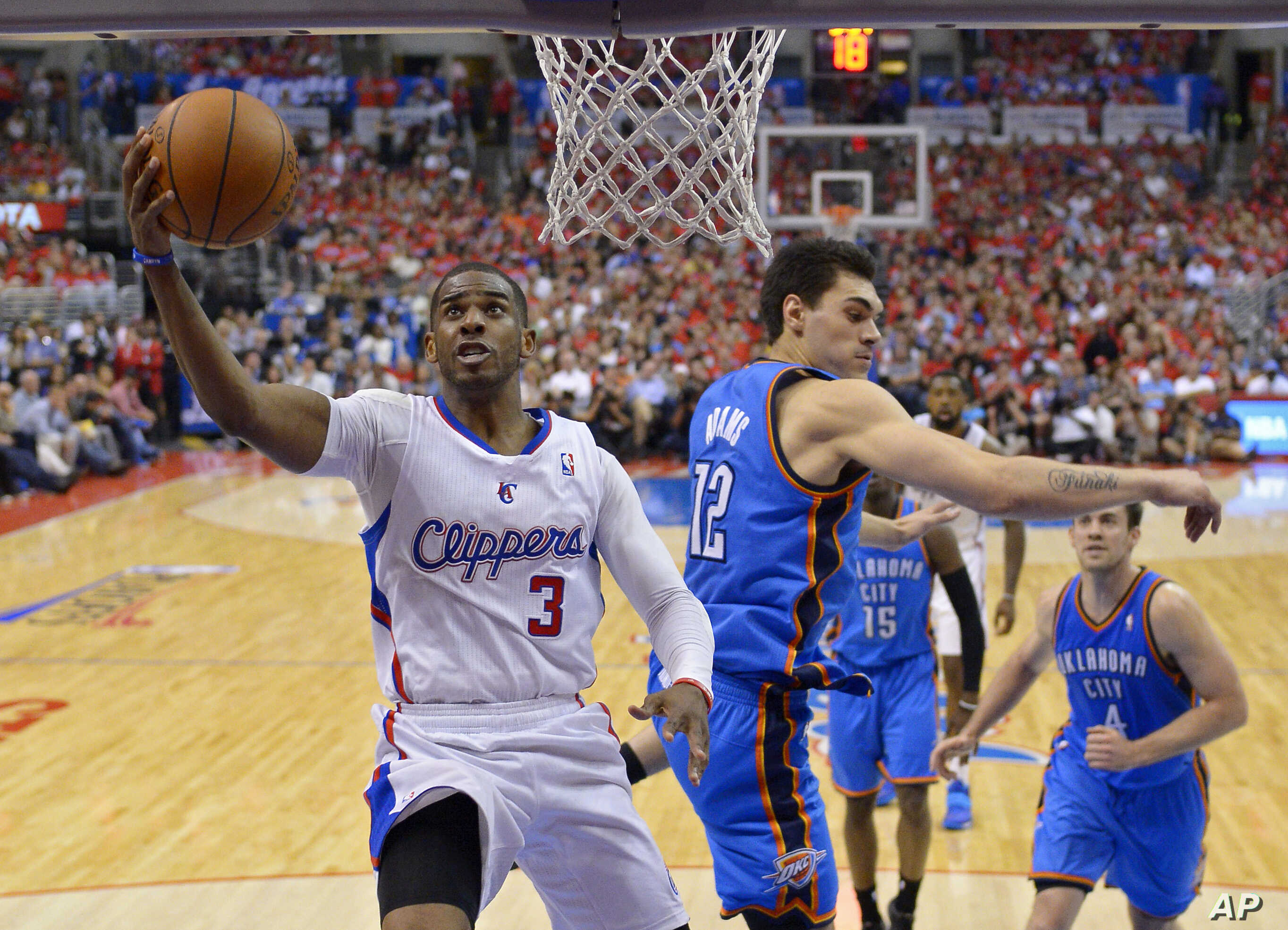 FILE: The Los Angeles Clippers' Chris Paul, left, puts up a shot against Oklahoma City Thunder center Steven Adams during Game 6 of the Western Conference semifinal NBA playoffs in Los Angeles, Calif., on May 15, 2014.