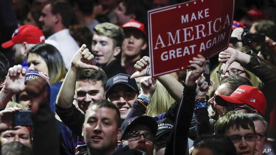 FILE -  attendees cheer at the media riser at the encouragement of President-elect Donald Trump while he speaks during the first stop of his post-election tour in Cincinnati.