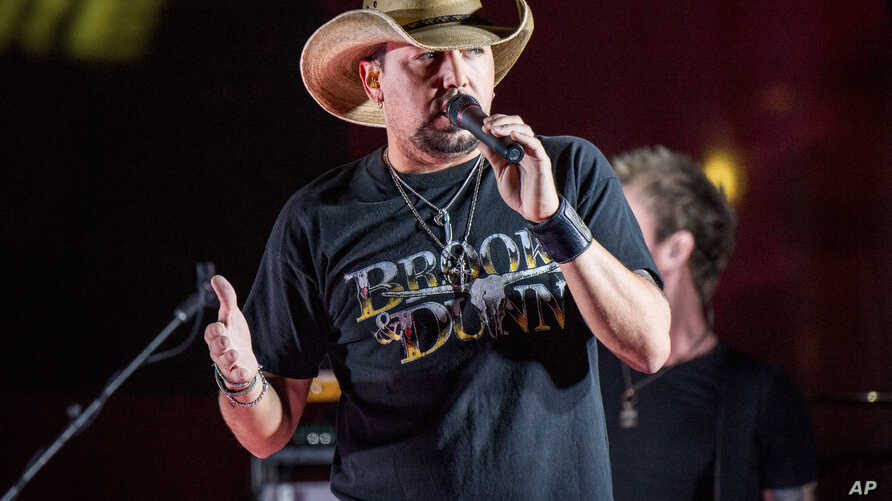 Country star Jason Aldean performs during a surprise pop up concert at the Music City Center in Nashville, Tenn., June 7, 2017.