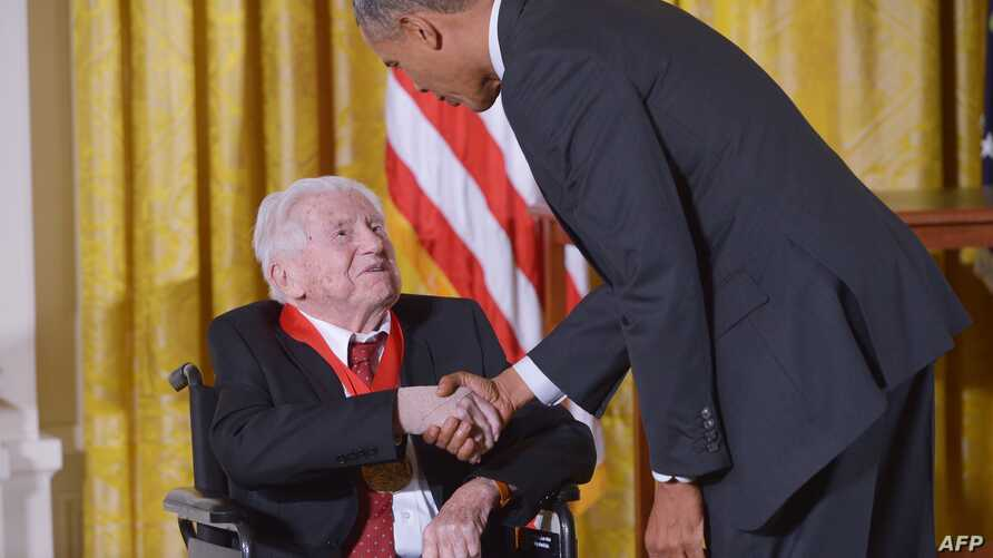 FILE - President Barack Obama presents the National Humanities Medal to literary critic M.H. Abrams during a ceremony in the East Room of the White House, in Washington, D.C., July 28, 2014.