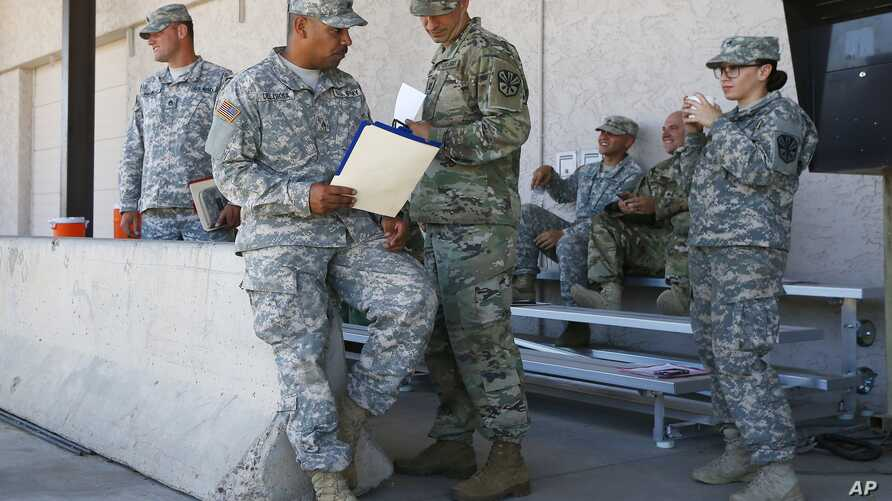 Arizona National Guard soldiers receive their reporting paperwork prior to deployment to the Mexico border at the Papago Park Military Reservation in Phoenix, April 9, 2018.