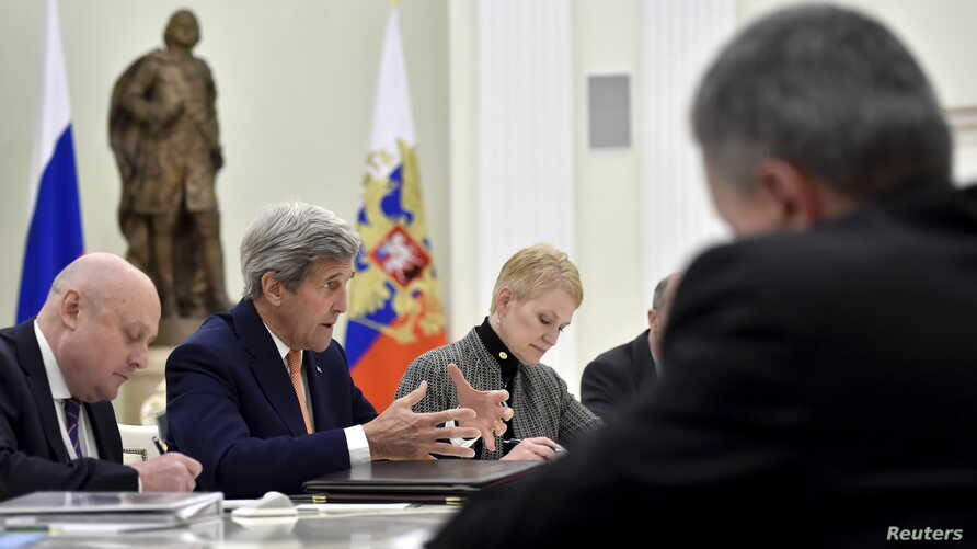 US Secretary of State John Kerry (2nd L) speaks during a meeting with Russian President Vladimir Putin (not pictured) at the Kremlin in Moscow, March 24, 2016.